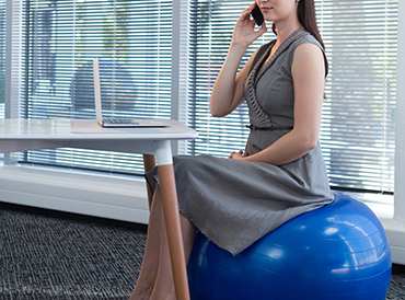 a lady on an exercise ball